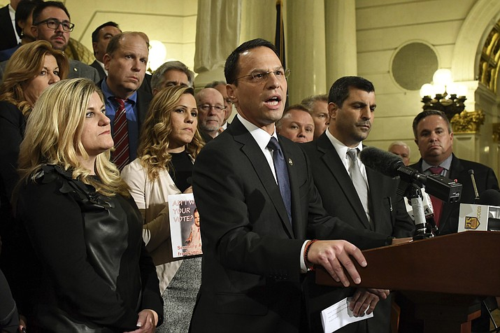 Attorney General Josh Shapiro of Pennsylvania speaks at a news conference in the state Capitol after legislation to respond to a landmark grand jury report accusing hundreds of Roman Catholic priests of sexually abusing children over decades stalled in the Legislature, Wednesday, Oct. 17, 2018, in Harrisburg, Pa. Shapiro is flanked by lawmakers and victims of child sexual abuse. (Marc Levy/AP)