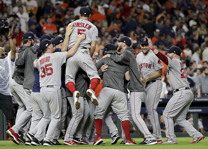 The Boston Red Sox celebrate after winning Game 5 of a baseball American League Championship Series against the Houston Astros on Thursday, Oct. 18, 2018, in Houston. (David J. Phillip/AP)