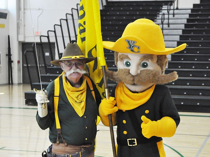 Tom Gammill stands with Yavapai College's new mascot, Ol' Ruff, as he passes the torch as the Roughriders' next mascot. Gammill has dressed as Mr. Roughrider for almost 20 years. The college is celebrating Ruff's legacy and his 45th birthday on Friday, Oct. 19, during a home volleyball game in Prescott. (YC/Courtesy)