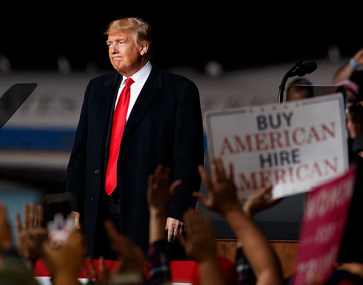 President Donald Trump looks the the cheering audience as he leaves a campaign rally at Minuteman Aviation Hangar, Thursday in Missoula, Mont. (Carolyn Kaster/AP Photo)