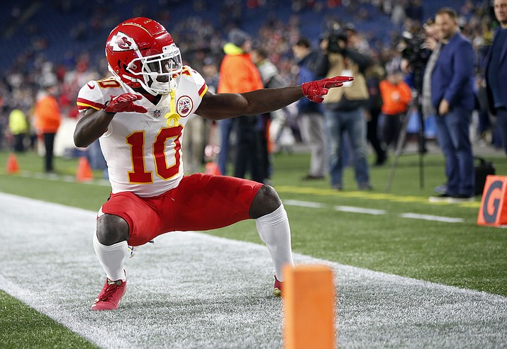 In this Sunday, Oct. 14, 2018, file photo, Kansas City Chiefs wide receiver Tyreek Hill strikes a pose as he warms up before an NFL football game against the New England Patriots in Foxborough, Mass. It's been a while since the NFL flexed a game to Sunday night. The Bengals vs. Chiefs is a worthy choice, (Michael Dwyer/AP, File)