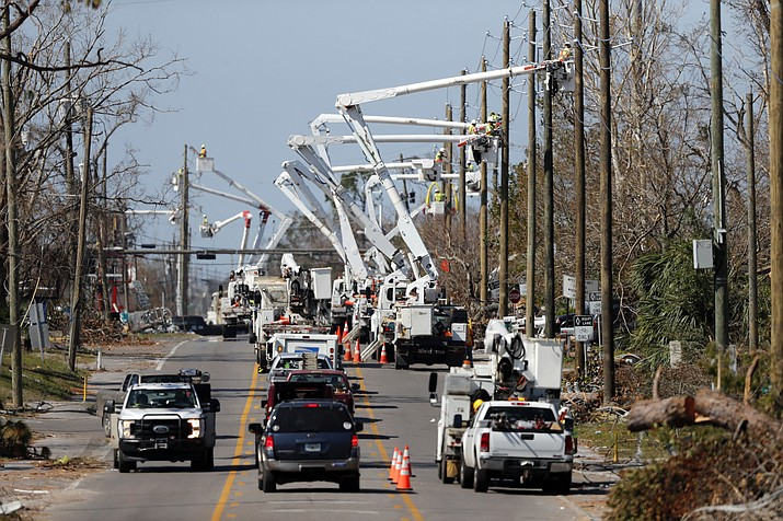 In this Thursday, Oct. 18, 2018 photo, utility crews set up new poles and utility wires in the aftermath of Hurricane Michael in Panama City, Fla. It's the greatest need after a hurricane and sometimes the hardest one to fulfill: Electricity. More than a week after Hurricane Michael smashed into the Florida Panhandle on a path of destruction that led all the way to the Georgia border, more than 100,000 Florida customers were still without power, according to the state Department of Emergency Management website. (Gerald Herbert/AP)