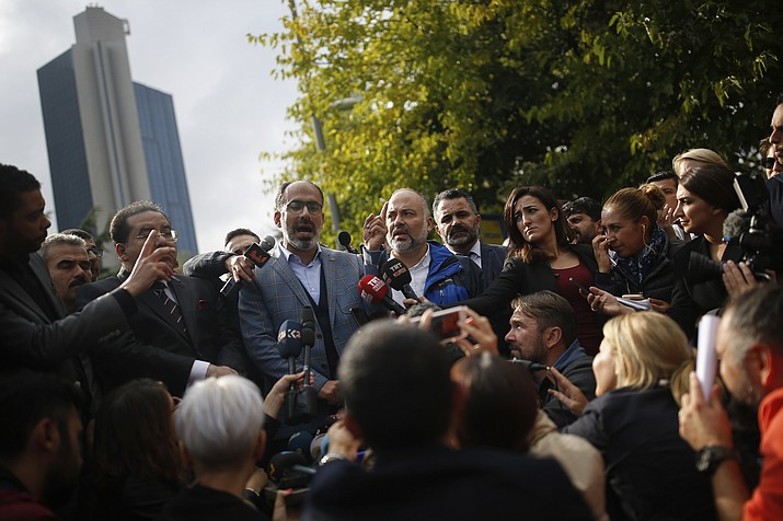 "Turan Kislakci, head of the Turkish-Arab media association and friend of Saudi journalist Jamal Khashoggi talks to the media, near Saudi Arabia's consulate in Istanbul, Saturday, Oct. 20, 2018. Turkey will ""never allow a cover-up"" of the killing of Saudi journalist Jamal Khashoggi in Saudi Arabia's consulate in Istanbul, a senior official in Turkey's ruling party said Saturday after Saudi Arabia announced hours earlier that the writer died during a ""fistfight"" in its consulate. (Emrah Gurel/AP)"