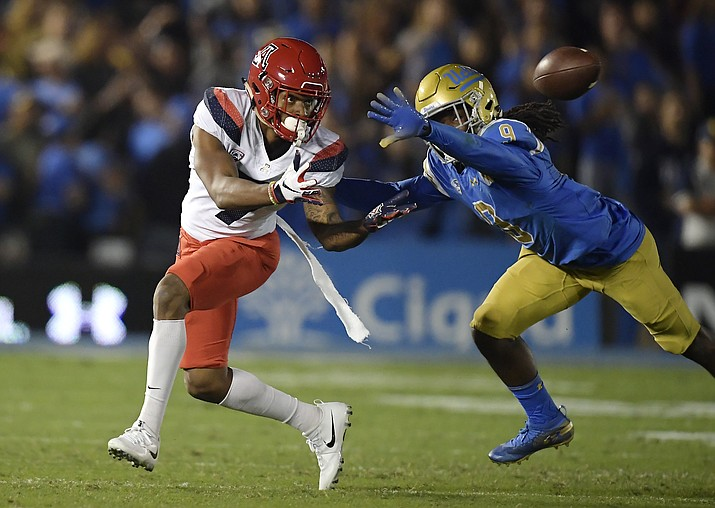 Arizona wide receiver Devaughn Cooper, left, attempts a catch as UCLA defensive back Elijah Gates knocks it down during the first half of an NCAA college football game Saturday, Oct. 20, 2018, in Pasadena, Calif. (Mark J. Terrill/AP)