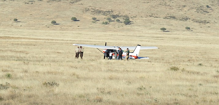 """The pilot of this Cessna 172 landed the plane Friday, Oct. 19, east of Fain Road and south of Arizona Downs, because the plane lost power on a """"just-replaced engine,"""" he told authorities. (Les Stukenberg/Courier)"""