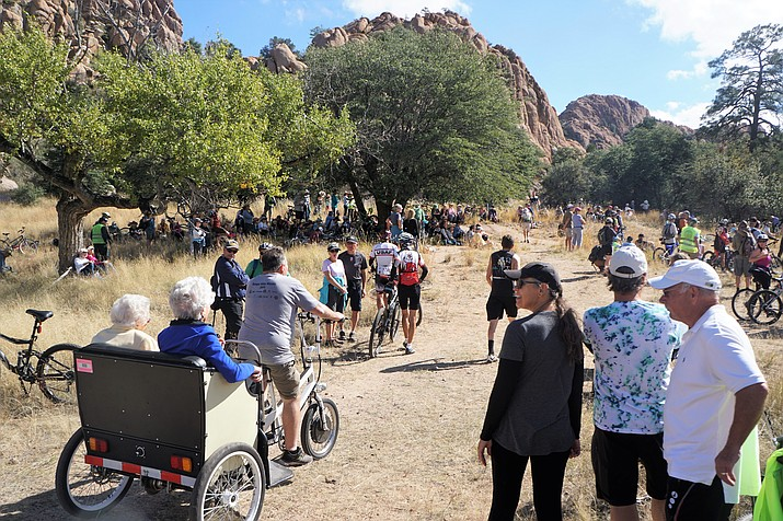 "A bike taxi transports long-time Prescott residents Elisabeth Ruffner, 99, left, and Rosemary Rusing, 96, into the ""Save the Dells"" rally at the Point of Rocks along the popular Peavine Trail. Ruffner and Rusing were among the 500 or 600 people who turned out for the Saturday, Oct. 20 rally. (Cindy Barks/Courier)"