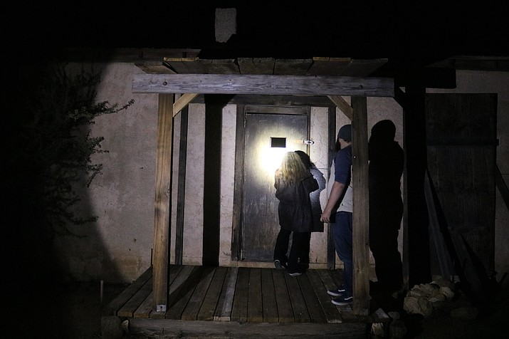 Tim Gardner and Daena Smoller outside of the old jail in Chloride that has two cells with two areas for a toilet and the sheriff's quarters. (Photo by Vanessa Espinoza/Daily Miner)