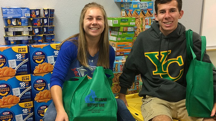 Local youth give thanks for their good fortune by collecting food to thwart local hunger