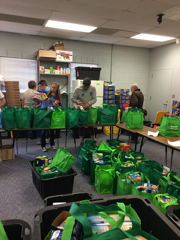 Chino Valley volunteers sort through donated green bags for the local Hungry Kids project and emergency food pantry. (Nanci Hutson/Courier)