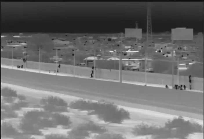 This image from video provided by the Yuma Sector Border Patrol shows a large group of Central American migrants being dropped over the U.S.-Mexico border wall east of the San Luis Port of Entry in Yuma, Arizona, on Friday, Oct. 19, 2018. (Yuma Sector Border Patrol via AP)