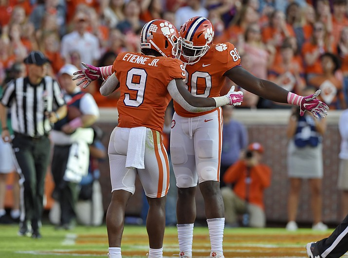 Clemson's Travis Etienne (9) celebrates with Milan Richard after scoring a touchdown during the second half of an NCAA college football game against North Carolina State, Saturday, Oct. 20, 2018, in Clemson, S.C. (Richard Shiro/AP)