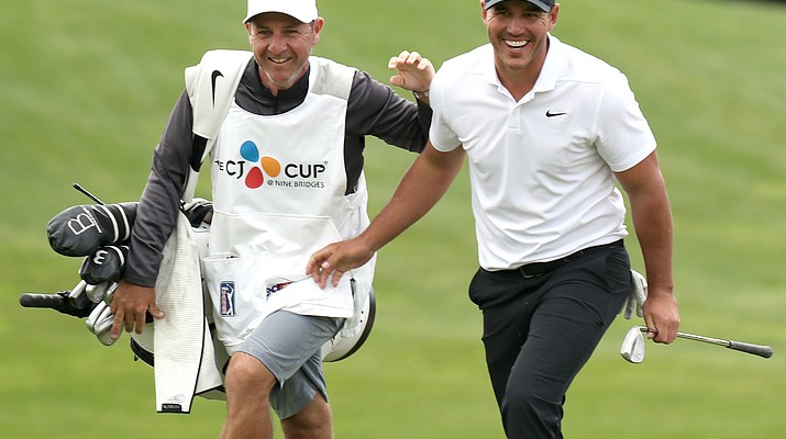 Koepka moves atop rankings with win at CJ Cup