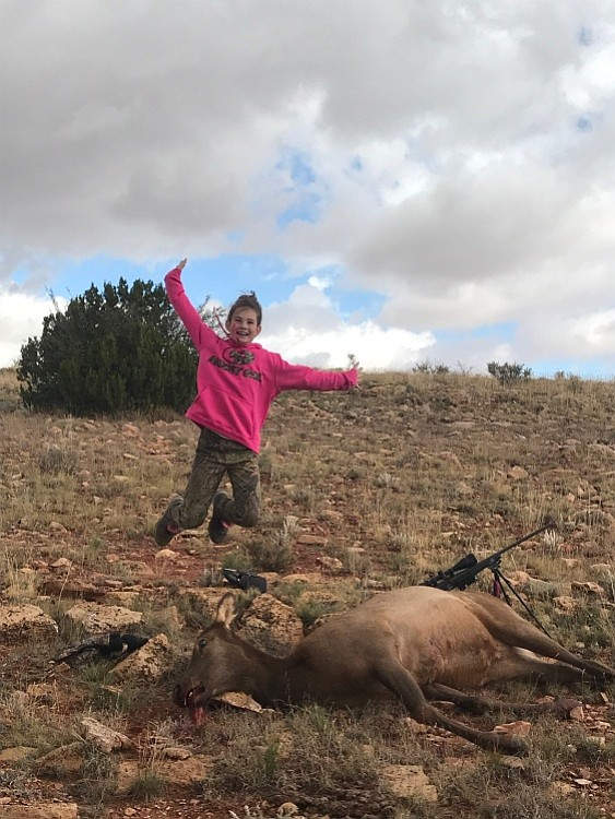 Aubree Gordon jumps for joy after bagging her first elk. Photo special to the Miner