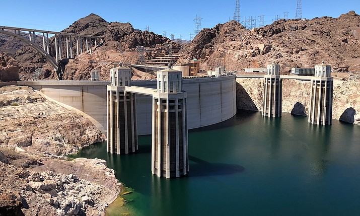Hoover Dam's penstock towers take in water from Lake Mead and use it to generate electricity. With less water, the dam generates less electricity, so officials replaced some of the dam's turbines to increase efficiency. (Jordan Evans/Cronkite News)
