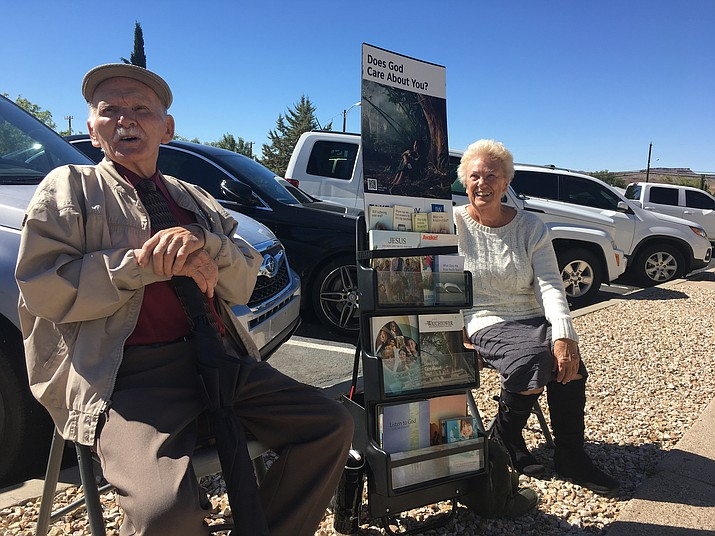 Mel and Helga Duarte distribute Jehovah's Witnesses literature outside Mohave County Superior Court. If we live by the Bible, we won't have to worry about the past, they said. (Photo by Hubble Ray Smith/Daily Miner)