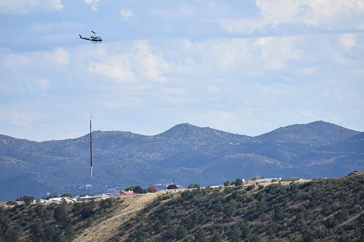Arizona Public Service (APS) helicopters a power pole above Prescott Valley Sunday, Oct. 21. (Richard Haddad/WNI)