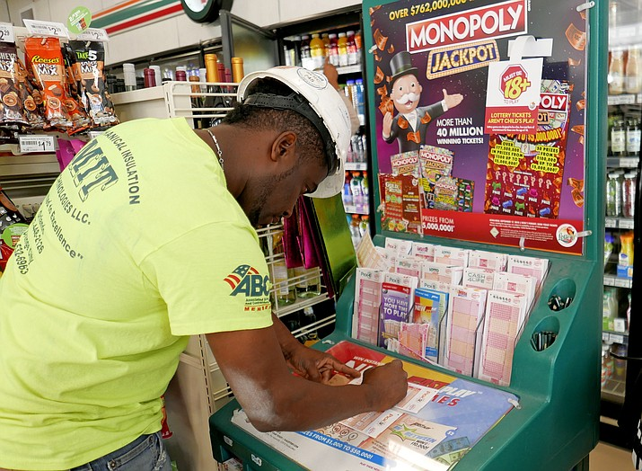 Jean Pierre fills out several Mega Millions lottery tickets for purchase at a convenience store Monday, Oct. 22, 2018, in Orlando, Fla. No one won the $1 billion jackpot in Saturday night's drawing, which means the top prize for Tuesday night's Mega Millions drawing would be the largest lottery jackpot in U.S. history. (John Raoux/AP)