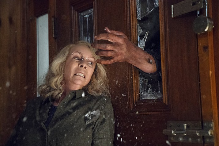 "This image released by Universal Pictures shows Jamie Lee Curtis in a scene from ""Halloween,"" in theaters nationwide on Oct. 19. (Ryan Green/Universal Pictures)"