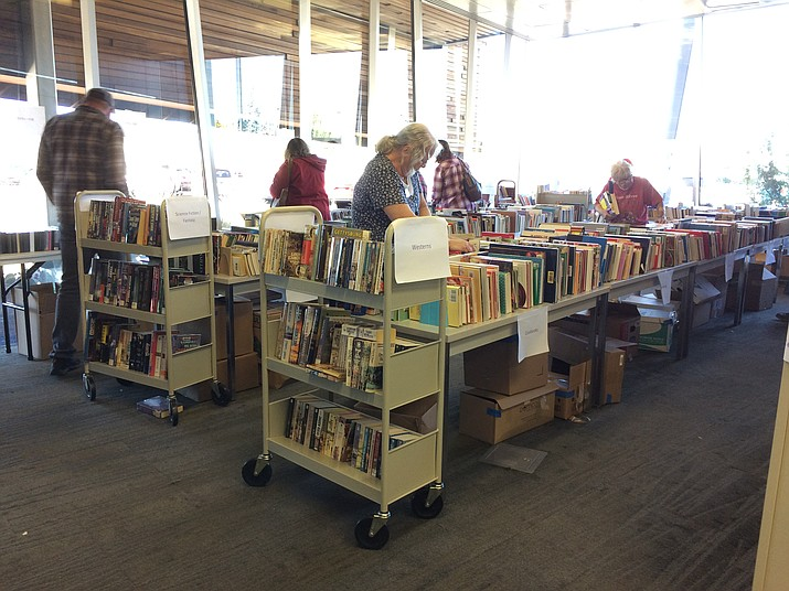 Readers shop for interesting books or potential gifts for others at the Friends of the Prescott Valley Public Library used book sale Friday, Oct. 19. (Sue Tone/Tribune)