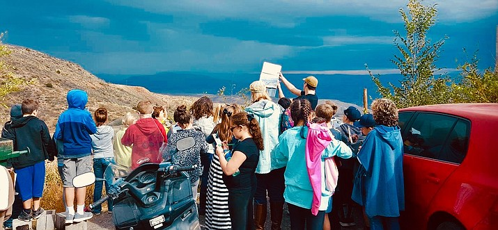 Tour guide Joe Westcott gives a tour to a group of kids in Jerome. Westcott said he never liked high school but wants to prove with his tours that learning history can be fun. When he conducts his tours, he always encourages people to ask questions – especially kids. Courtesy photo