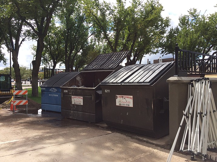 Trash dumpsters' new location at the southwest corner of the Yavapai County Courthouse Plaza Oct. 7 provides more safety to the courthouse building and also allows Sheriff's deputies a place to park when transporting prisoners to their hearings. (Sue Tone/Courier)