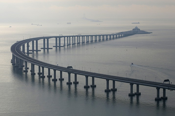 The Hong Kong-Zhuhai-Macau Bridge is seen in Hong Kong, Monday, Oct. 22, 2018. The bridge, the world's longest cross-sea project, which has a total length of 55 kilometers (34 miles), will have opening ceremony in Zhuhai on Oct. 23. (AP Photo/Kin Cheung)