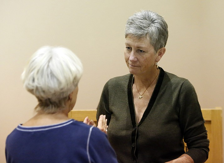 Grand Canyon National Park Superintendent Christine Lehnertz, right, speaks with a member of the public at an October, 2017 event at the Museum of Northern Arizona in Flagstaff. The National Park Service says Lehnertz will be reassigned temporarily while a federal watchdog investigates undisclosed allegations. (Benji Shanahan/Arizona Daily Sun via AP)