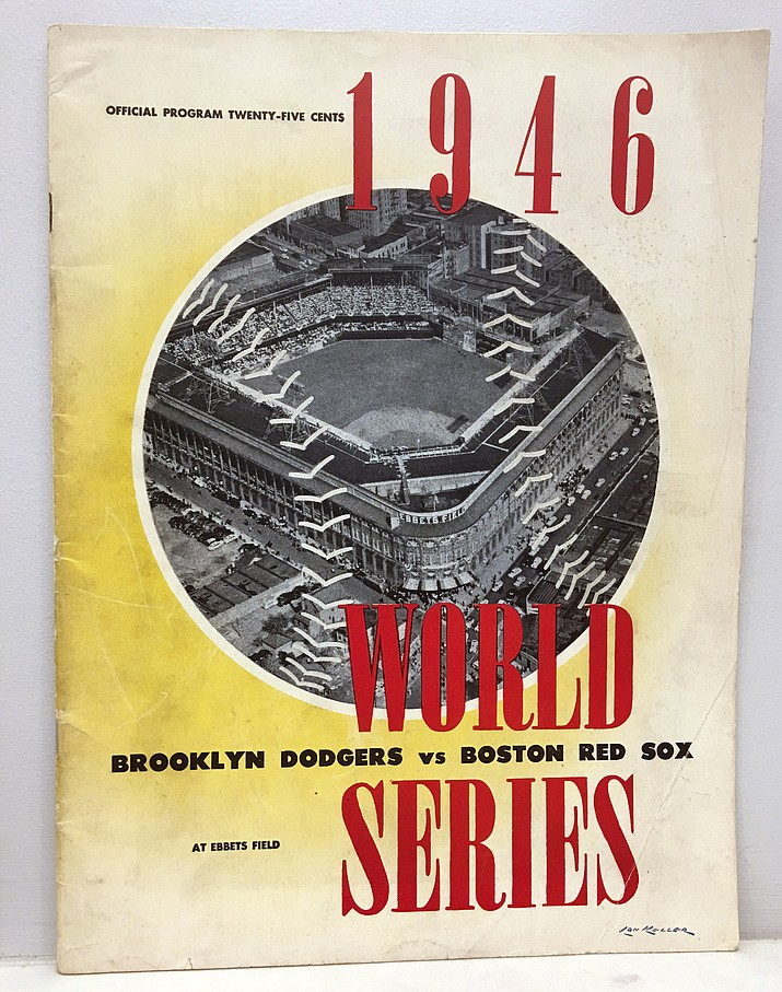 This photo provided by Jordan Sprechman shows a program printed in advance, in anticipation of a 1946 World Series matchup between the Boston Red Sox and the Brooklyn Dodgers at Ebbets Field. But there was no World Series that October between the Red Sox and Dodgers _ instead, Brooklyn lost a best-of-three playoff to St. Louis for the National League pennant. Instead of being sold at Ebbets Field, these programs became a long-lost souvenir of a phantom World Series that never was. (Jordan Sprechman via AP)