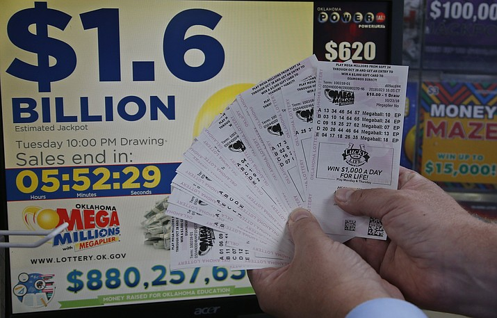 A customer, who did not want to be identified, displays the $200.00 worth of Mega Millions tickets he bought at Downtown Plaza convenience store in Oklahoma City, Tuesday, Oct. 23, 2018. (Sue Ogrocki/AP)