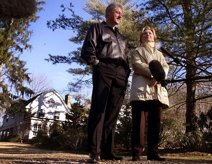 "In this Jan. 6, 2000 file photo, Bill and Hillary Clinton stand in the driveway of their new home in Chappaqua, N.Y. A U.S. official says a ""functional explosive device"" was found at Hillary and Bill Clinton's suburban New York home. (AP Photo, File)"