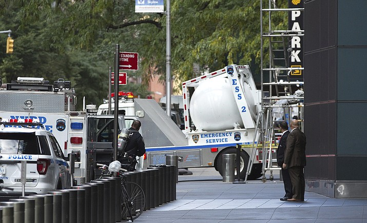An NYPD bomb squad vehicle departs an area outside Time Warner Center on Wednesday, Oct. 24, 2018, in New York. Law enforcement officials say a suspicious package that prompted an evacuation of CNN's offices is believed to contain a pipe bomb. (Kevin Hagen/AP)