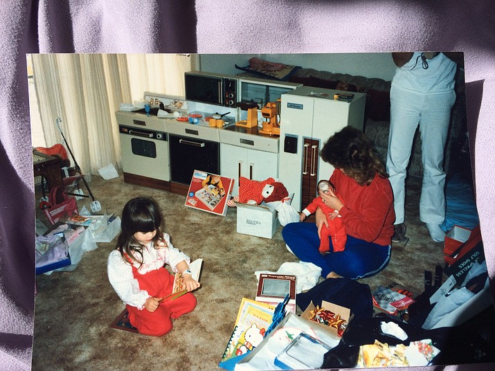 Kathy Stephens (sitting on floor) and her young daughter at their California house in the 1980s. The room they're sitting in was where a spooky experience took place. (Kathy Stephens/Courtesy)