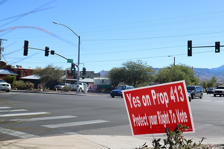 """Signs advocating for """"yes"""" votes on Proposition 413 placed in public rights of way have been deemed permissible by City Attorney Carl Cooper. (Photo by Travis Rains/Daily Miner)"""