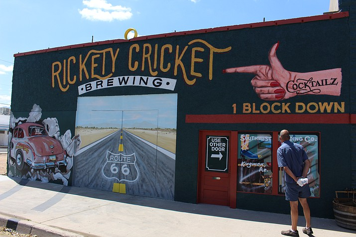 "A tourist stops to look at a mural of ""Searchlight Sally"" in downtown Kingman. Arizonans believe the arts improves the quality of life in their communities, according to recent survey.(Photo by Hubble Ray Smith/Daily Miner)"