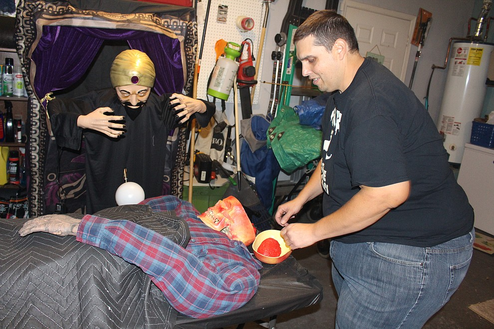 Daniel Liska works on his mini-morgue display that will be set up in his driveway at 3766 Steel Ave. on Halloween night. (Photo by Hubble Ray Smith/Daily Miner)