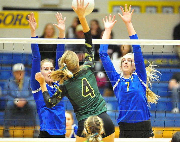 Prescott's Helen Burger and Kathrine Radavich go for a block against Flagstaff on Oct. 18, 2018, in Prescott. The No. 21-ranked Badgers upset No. 12 Catalina Foothills 3-2 in the 4A state play-in round Thursday, Oct. 25, in Tucson. The win puts Prescott in the state playoffs for the sixth straight year. (Les Stukenberg/Courier, file)