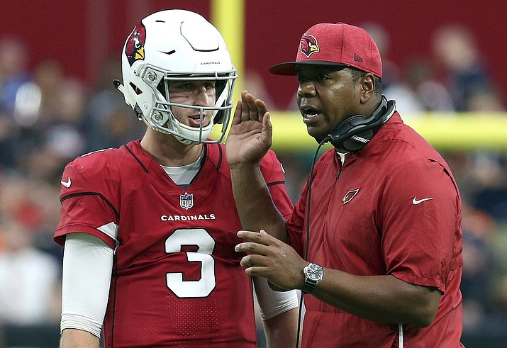 Arizona Cardinals rookie quarterback Josh Rosen talks with then-quarterbacks coach Byron Leftwich during the second half of the team's game against the Chicago Bears Sunday, Sept. 23, 2018, in Glendale, Ariz. Leftwich, who has been promoted to offensive coordinator, is the fifth coordinator that Rosen has had in the past five seasons. (Ralph Freso/AP file)