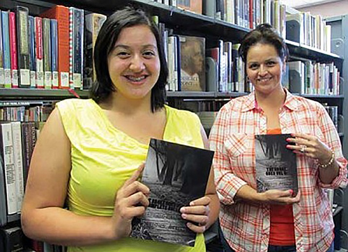 "Alexandria Smith, left, and her mother, Adelita Smith, display the abridged and complete volumes of ""The Broke Ones Vol. 2 Complete Version: Shadow of Memories."" Their poetry and photographs were recently published in the books. (KIM STEELE/Miner)"