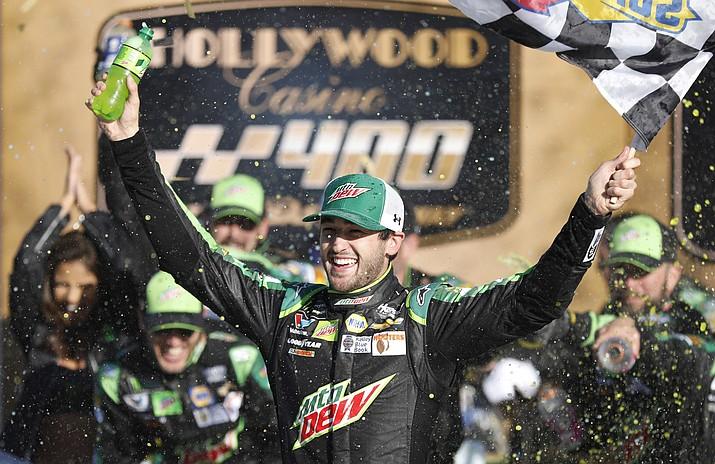 Chase Elliott celebrates winning a NASCAR Cup Series auto race at Kansas Speedway in Kansas City, Kan., Sunday, Oct 21, 2018. (Colin E. Braley/AP)