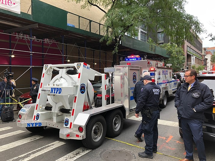 NYPD's Total Containment vessel arrives as law enforcement respond to the scene of a suspicious package at a postal facility, Friday, Oct. 26, 2018 in New York. Two law enforcement officials say a package closely resembling parcels sent to critics of President Donald Trump has been found at the postal facility in Manhattan. The suspicious package was discovered by postal workers. (AP Photo/Mark Lennihan)