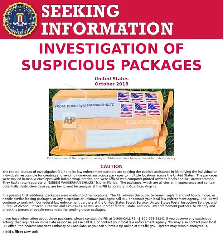 The FBI released this poster on Thursday, Oct. 25, 2018, asking for the public's assistance in finding the people responsible for sending suspicious packages to multiple locations across the United States. The targets of the packages were some of the figures most frequently criticized by President Donald Trump. (FBI)