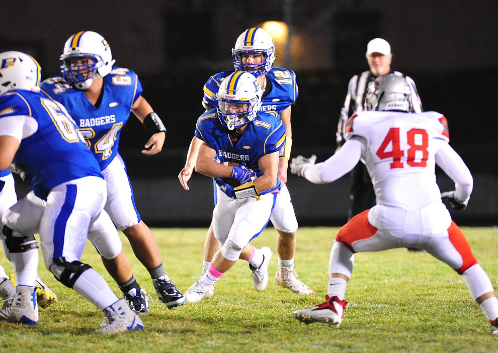 Prescott's Sylas Espitia runs for hard yards as the Badgers play cross mountain rival Mingus for the region title Friday, Oct. 26, 2018 in Prescott. (Les Stukenberg/Courier).