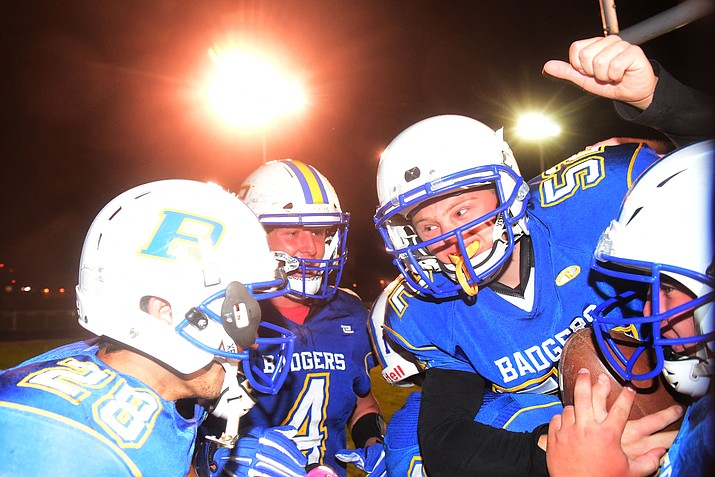 Ryan Tardibuono (52) is lifted by Prescott football players after scoring a 25-yard touchdown run before the game against Mingus on Friday, Oct. 26, 2018, in Prescott. Tardibuono, who has Down syndrome, is a senior at Prescott and it was his dream to play football. (Les Stukenberg/Courier)