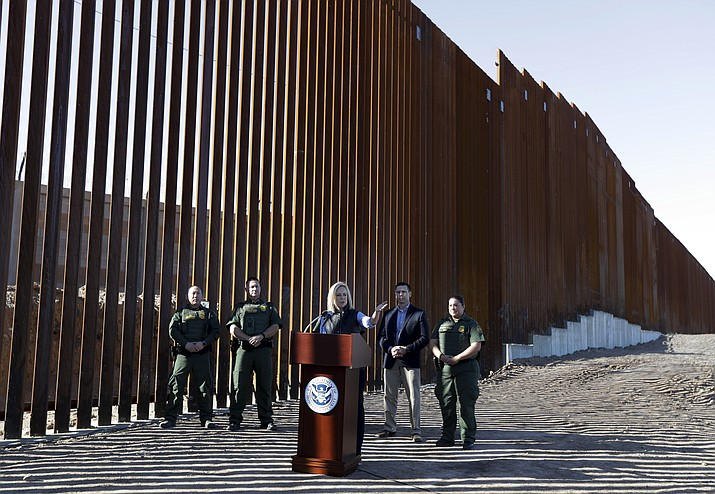 U.S. Department of Homeland Security Secretary Kirstjen Nielsen, center, speaks in front of a newly fortified border wall structure Friday, Oct. 26, 2018, in Calexico, Calif. (Gregory Bull/AP)