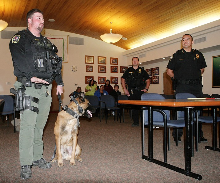 Yavapai-Apache Police Officer Joshua Collins, left, and his K9 partner Loki, talk with the Nation's Tribal Council on Thursday. VVN/Bill Helm