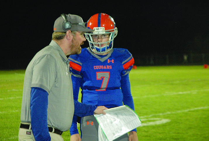 Chino Valley coach talks Wade Crug talks with Tyler Carey during Friday night's game. (Jason Wheeler/Courier)