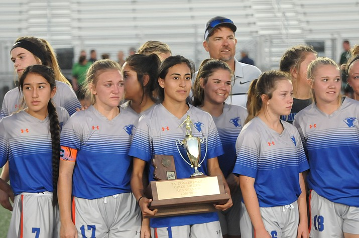 The Chino Valley girls soccer team stands for a photo while holding the 2A state runner-up trophy after a tough 3-1 loss to Northland Preparatory Academy in the 2A state finals Saturday, Oct. 27, 2018, in Gilbert. (Doug Cook/Courier)