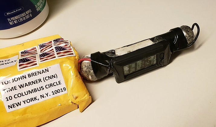 This image obtained Wednesday, Oct. 24, 2018, and provided by ABC News shows a package addressed to former CIA head John Brennan and an explosive device that was sent to CNN's New York office. (ABC News via AP)
