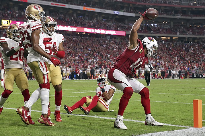 Arizona wide receiver Larry Fitzgerald celebrates his two-point conversion during the second half the Cardinals win over San Francisco, Sunday, Oct. 28, 2018, in Glendale. (Ralph Freso/AP)