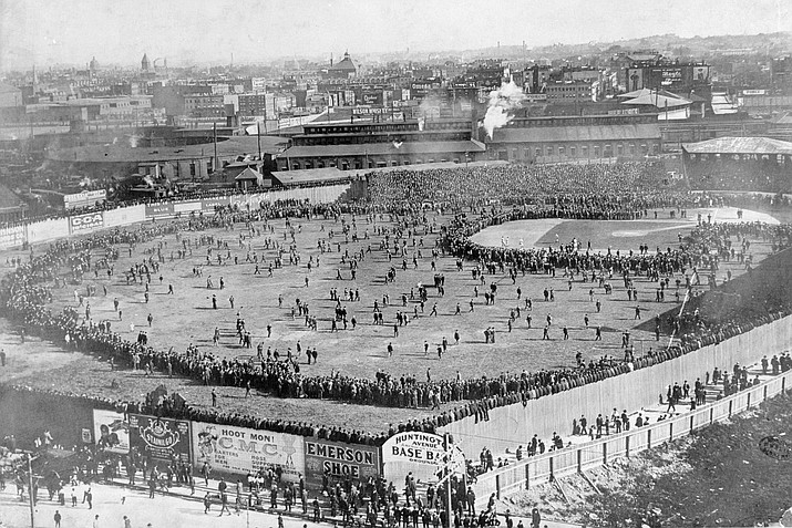 This aerial view shows the Huntington Avenue Baseball Grounds during the first World Series game between the Boston Pilgrims and the Pittsburgh Pirates in Boston, Ma., on Oct. 1, 1903. The Pirates defeated the Pilgrims in game one, 7-3. Boston went on to win the first American League versus the National League World Series, five games to three. (AP)